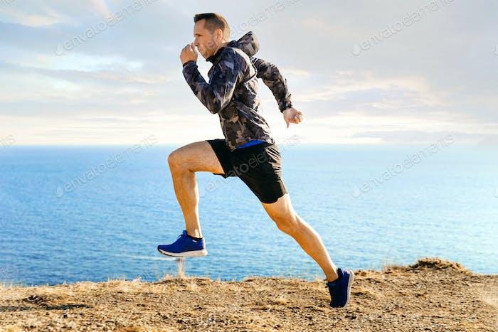 male runner in windbreaker running