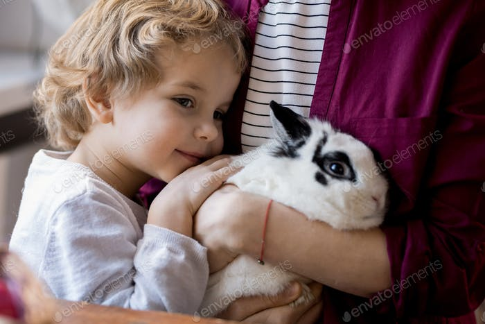 Adorable Little Boy Hugging Bunny
