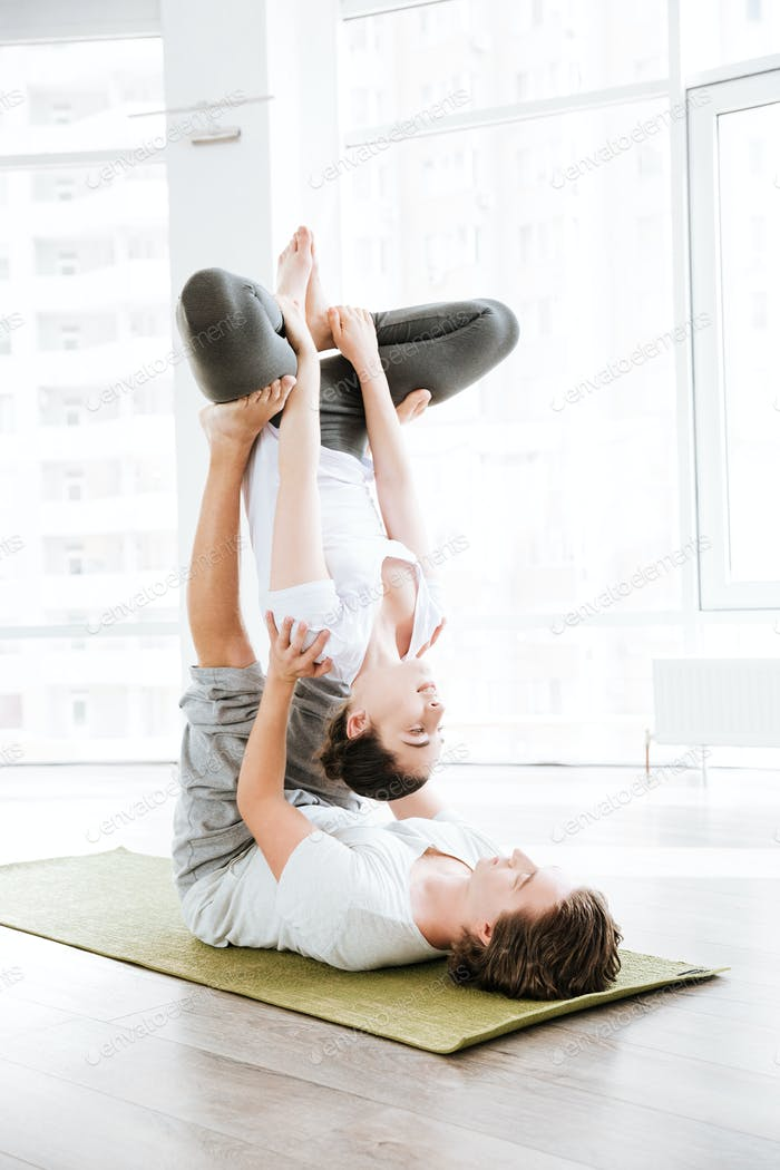 Young couple doing acro yoga