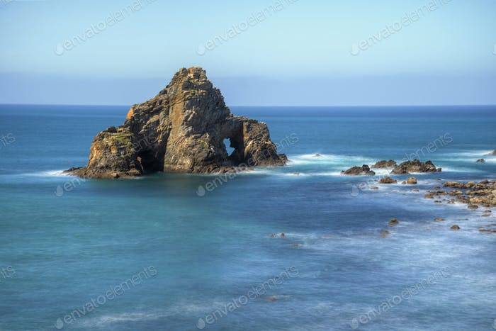 Marine rocky cliff with two arches