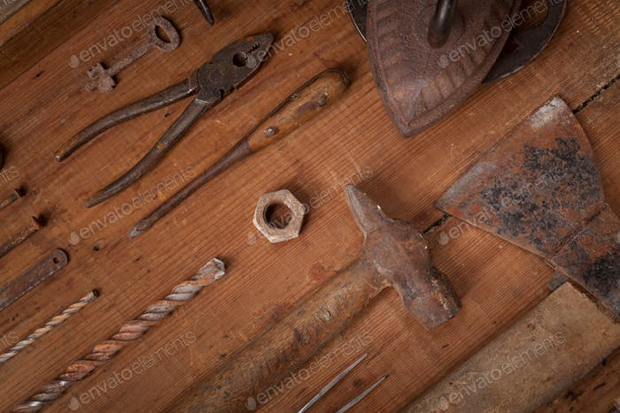 Collection of vintage tools on wooden background