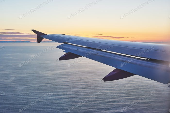 orning sunrise with Wing of an airplane. Photo applied to tourism operators. picture for add text