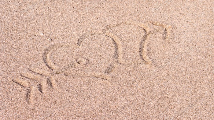 Two Hearts and arrow, We heart it, Drawn on Sand on the Beach, Bali, Indonesia