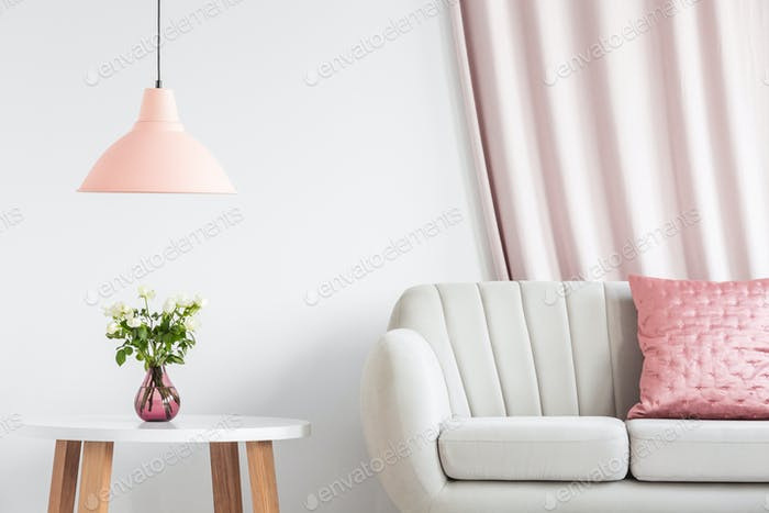 Peach lamp above wooden table