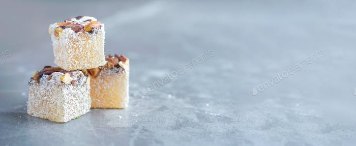 Turkish delight with pistachios on grey background. Copy space. Traditional eastern cuisine