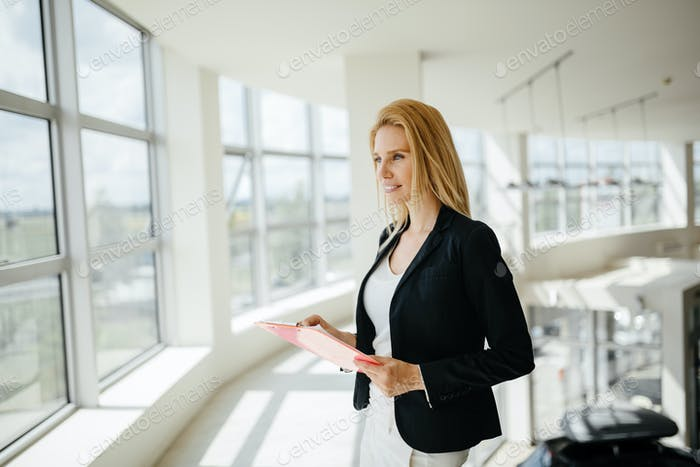 Beautiful businesswoman at company
