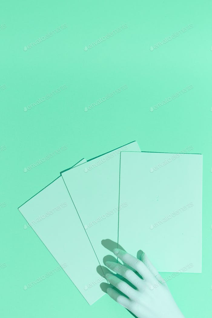 Minimal aesthetic still life monochrome design. Aqua menthe trends. Fake hand and paper