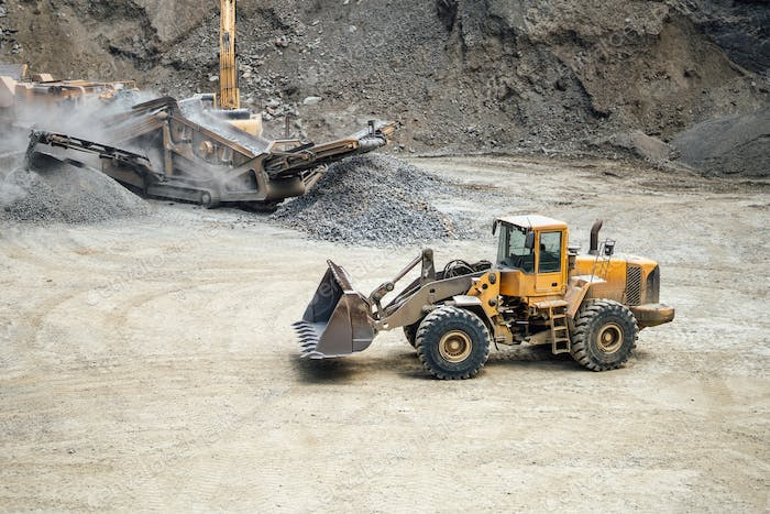 Industrial heavy duty bulldozer moving gravel on construction site