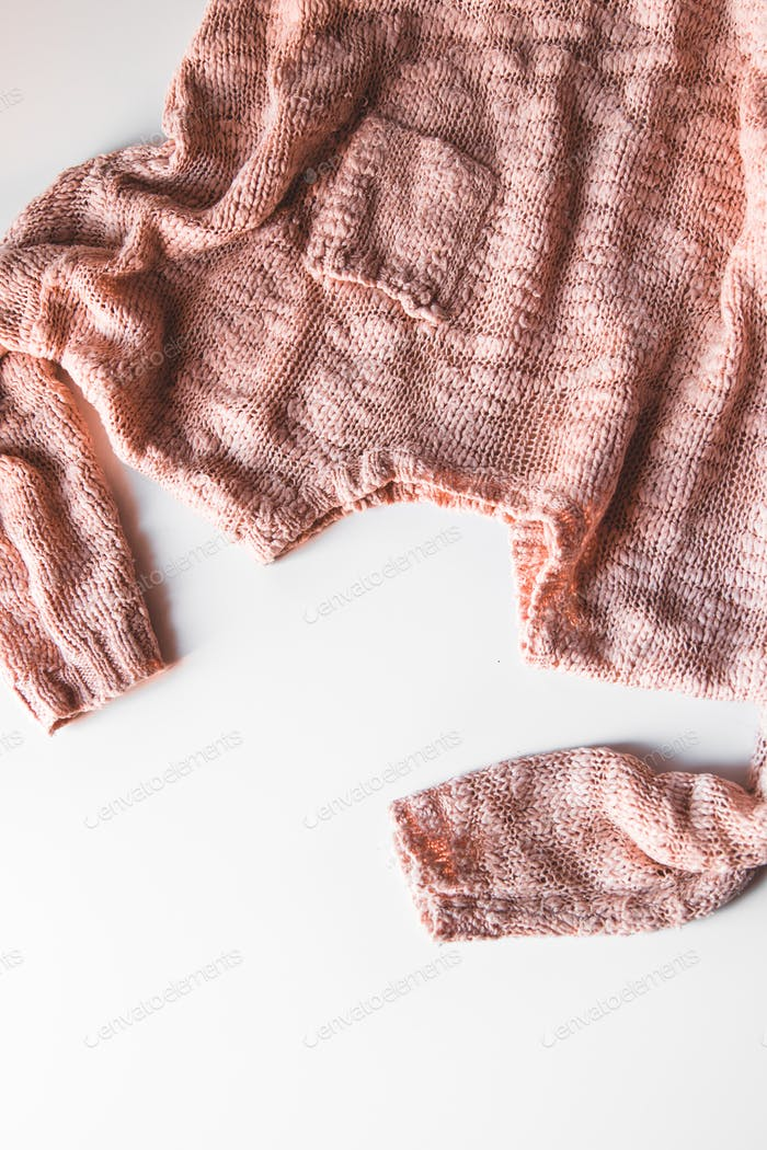 Warm knitted sweater with a pattern. Isolate on white