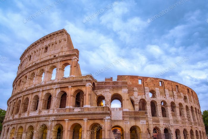 Front view of Roman Colosseum with dramatic sky