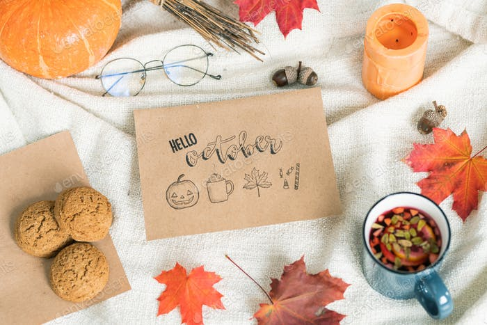October background with leaves, food and drink, acorns, candle and eyeglasses