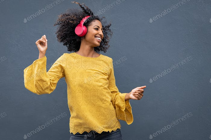 African woman dancing and listening music