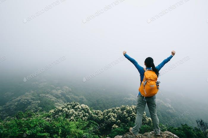 Feel free on spring foggy mountain top