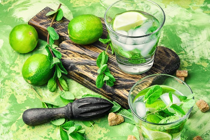 mojitos cocktail with lime and mint leaves