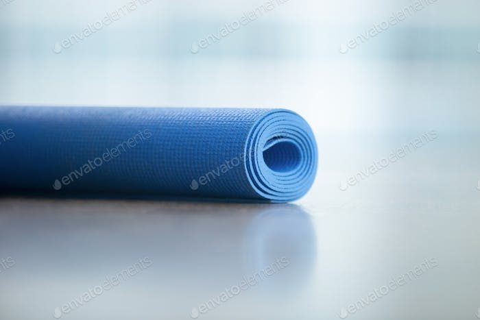 Close up of yoga, fitness floor mat