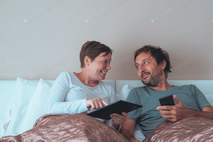 Happy couple, husband and wife in bedroom