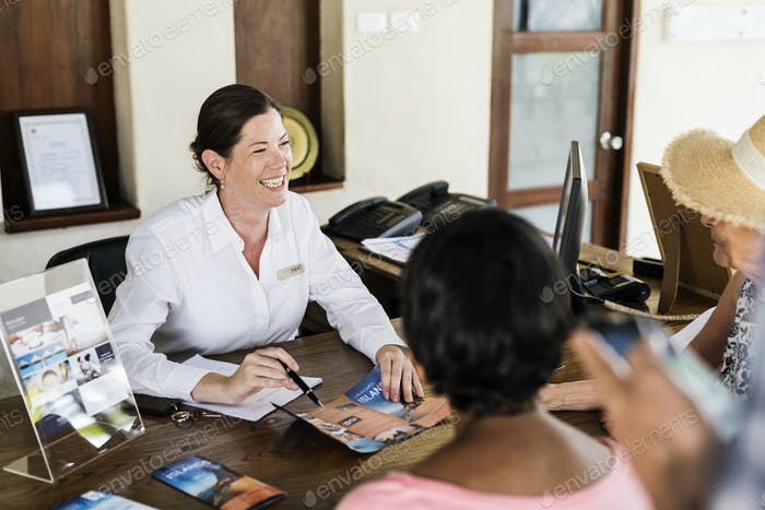 Resort receptionist speaking to a guest