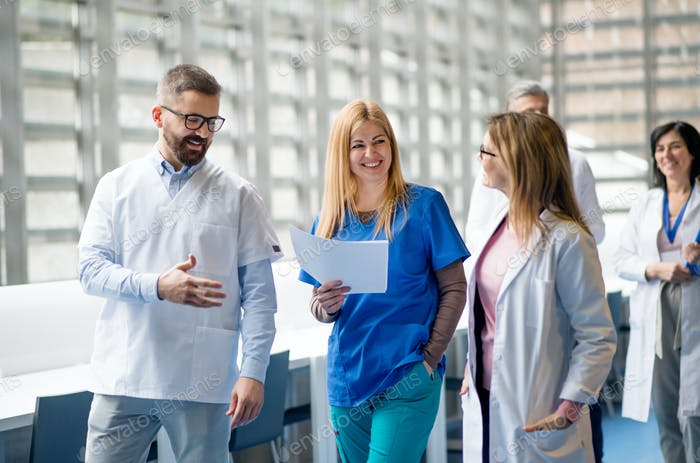 Group of doctors walking in corridor on medical conference
