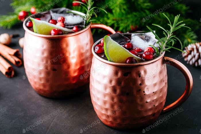 Moscow Mule cocktail with cranberries in copper mugs for Christmas