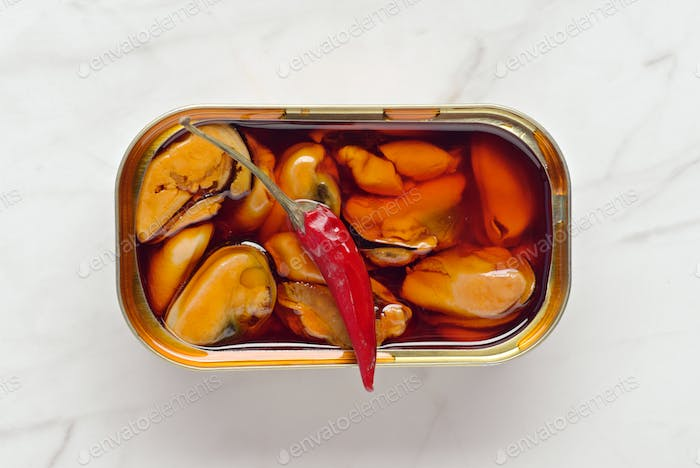 can of mussels with red chili