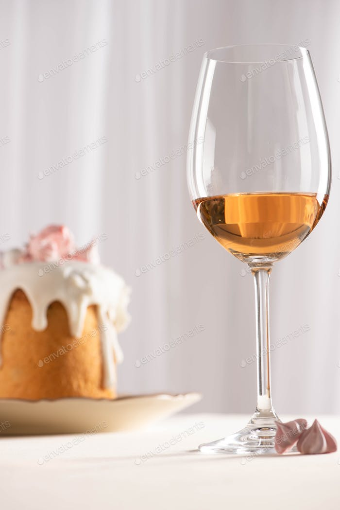 Selective Focus of Easter Cake Near Wine Glass And Meringue