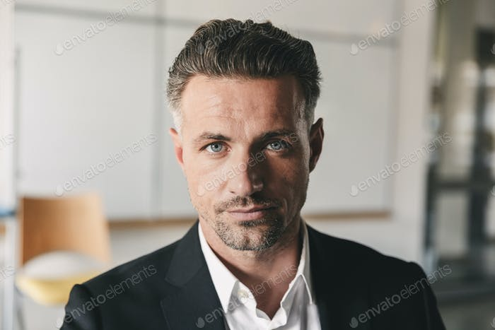 Portrait closeup of serious concentrated businessman wearing whi