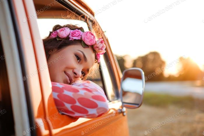 Beautiful hippie girl in a van