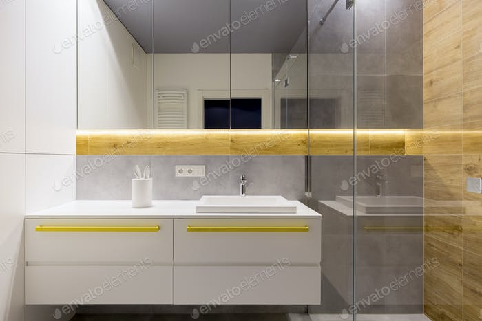 White bathroom with yellow accents