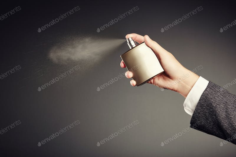 Man applying perfume photo by heckmannoleg on Envato Elements