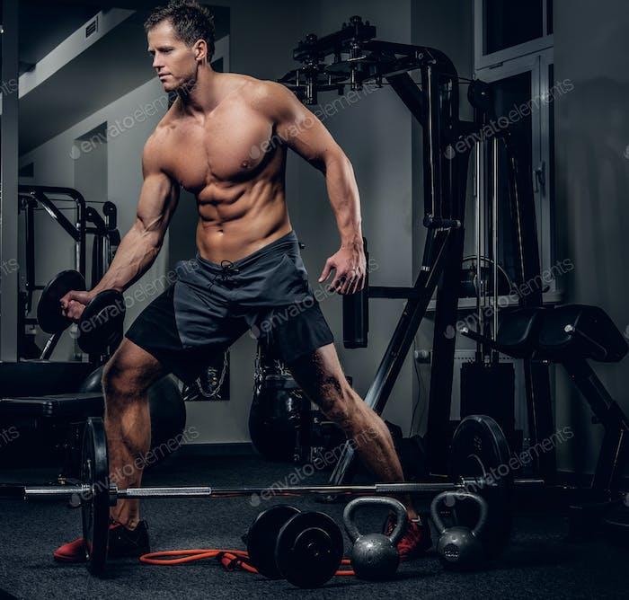 A man working hard in a gym club.