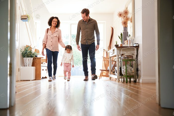 Family With Single Child Returning Home After Trip Out
