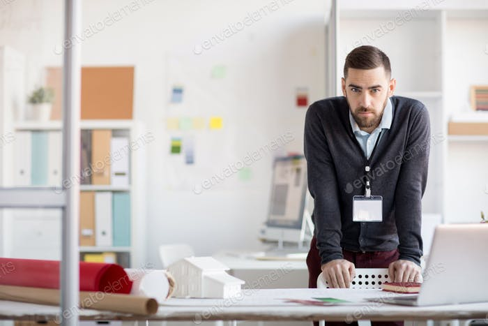 Serious Office Worker Looking at Camera