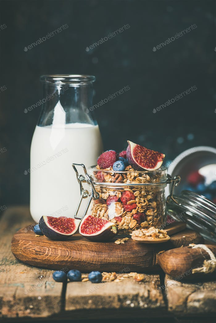 Oatmeal granola with bottled almond milk, honey, fruit and berries
