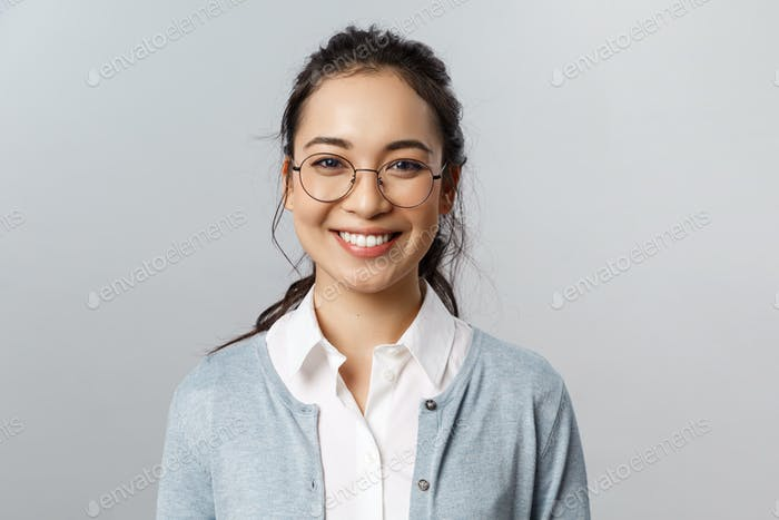 Close-up portrait of attractive, friendly-looking asian female office worker, employee or teacher in
