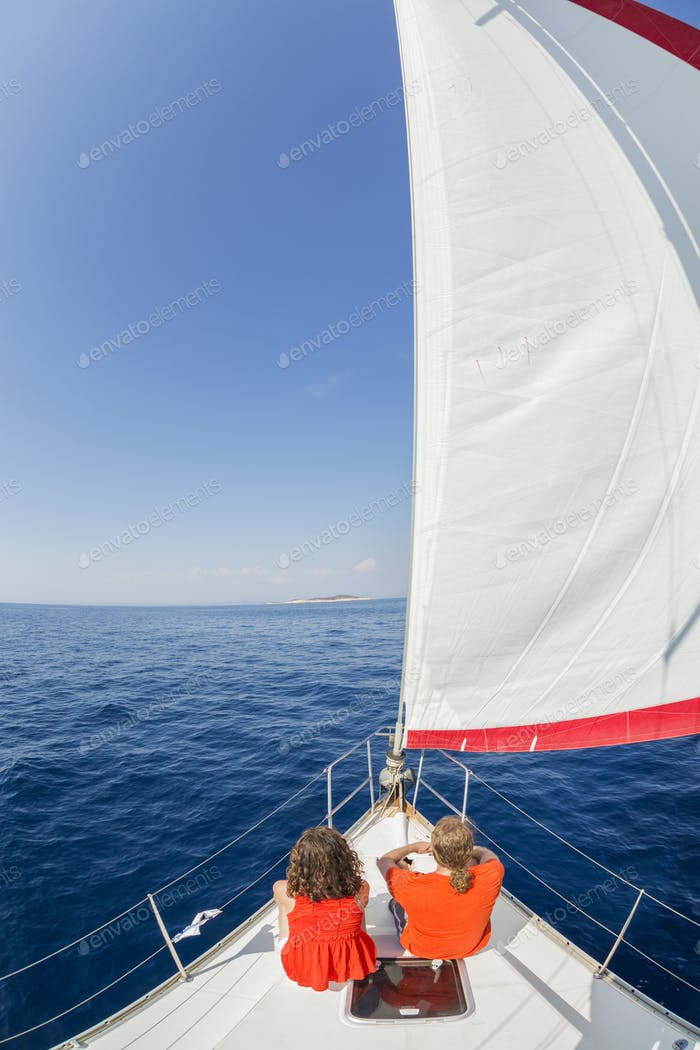 Man and woman on a sailing yacht on the Adriatic Sea.