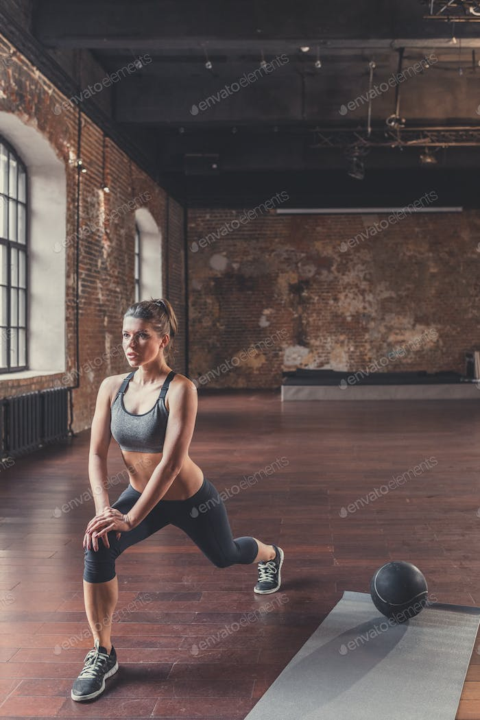 Athletic young girl in sports training