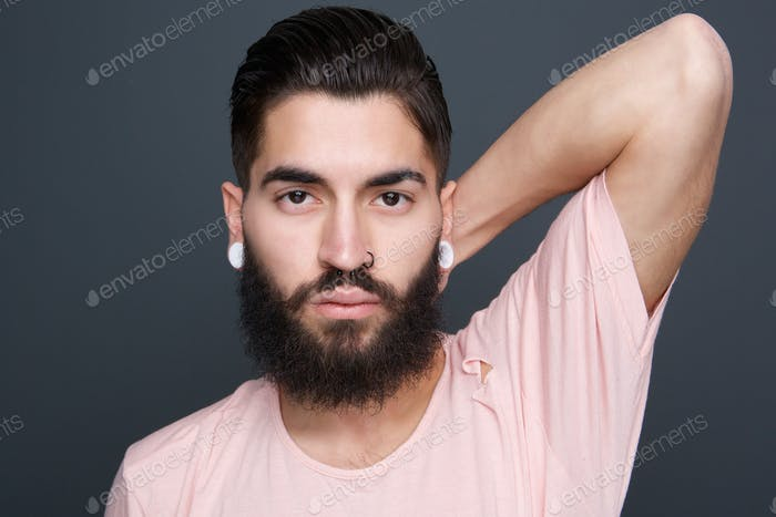 Handsome man with beard and piercings