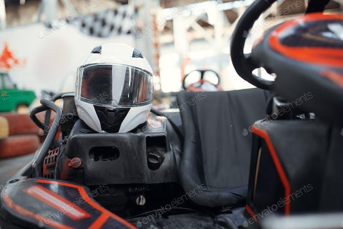 Helmet in go kart car closeup view, karting