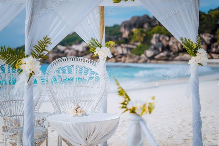 La Digue island, Seychelles. Decorated romantic wedding celebration accessories, table and chairs on