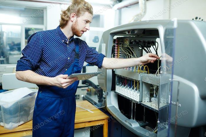 Checking printing machine