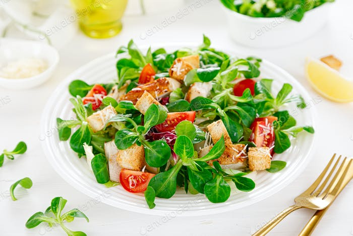 Caesar salad with grilled chicken meat. Healthy lunch,
