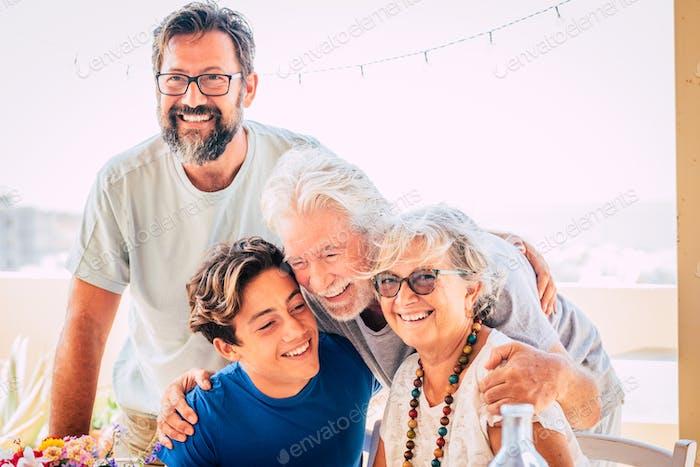 Happy mixed three generations family hug and happiness