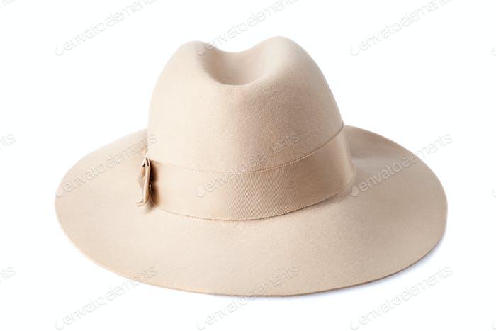 beige female felt hat isolated on white background