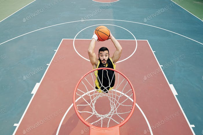 Player throwing ball in basket