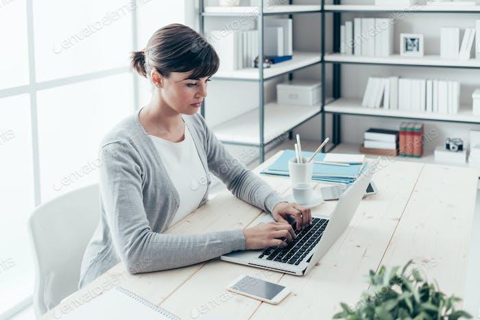 Confident businesswoman working at desk