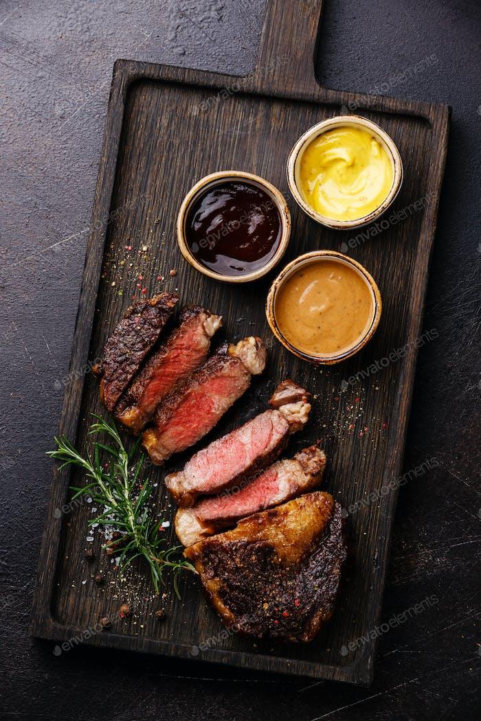 Sliced grilled Rib eye steak and three sauces