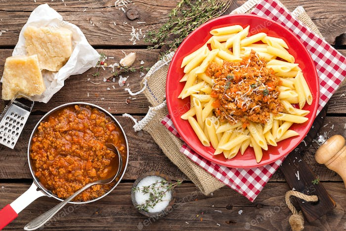 Pasta bolognese. Pasta served with a sauce of ground beef meat, tomato, onion, carrot and thyme