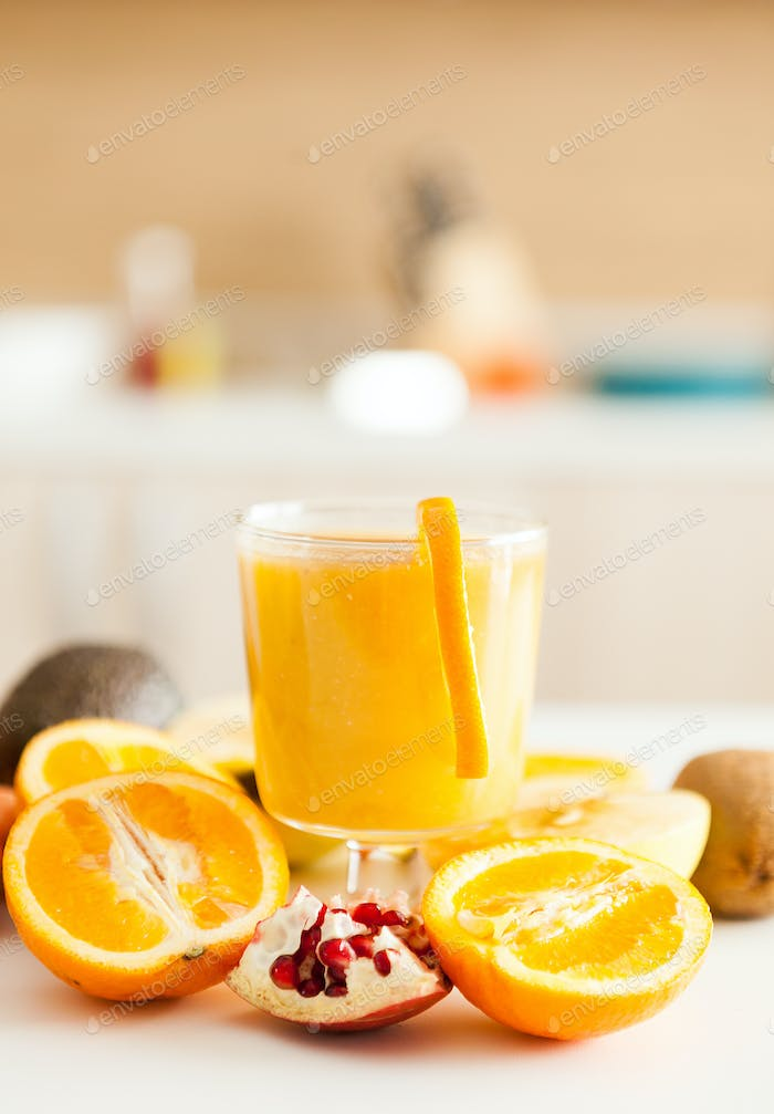 Fresh fruits, vegetables and smoothies in the kitchen
