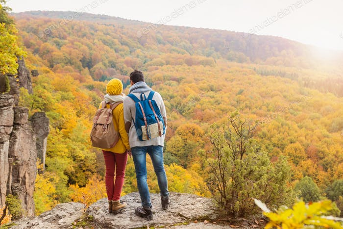 Beautiful couple in autumn nature