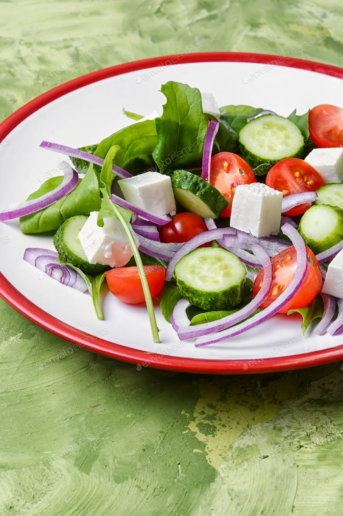 salad with spinach, cheese and tomato